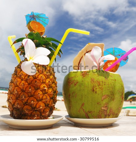 Tropical cocktails on the beach - stock photo