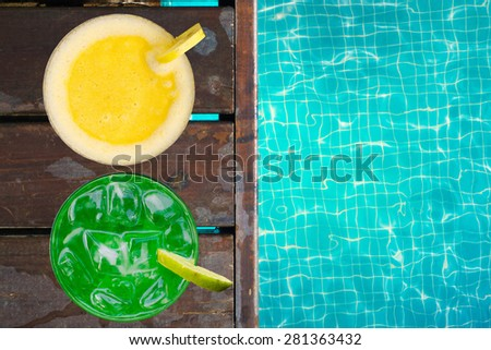 Tropical cocktaisl near swimming pool - stock photo