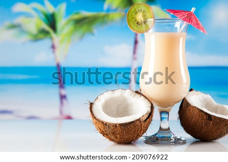 Tropical drinks on beach and sun - stock photo