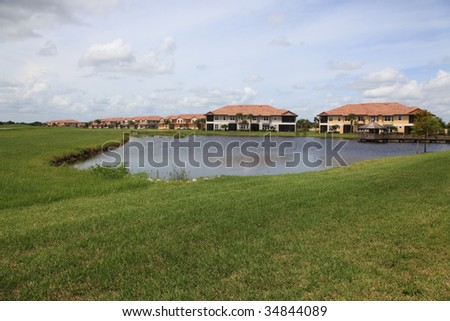 Tropical Florida housing tract with lake - stock photo