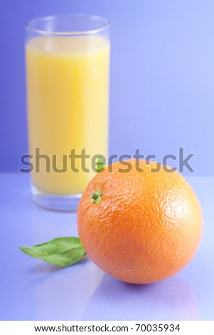 Tropical fruit and juice on blue background. - stock photo