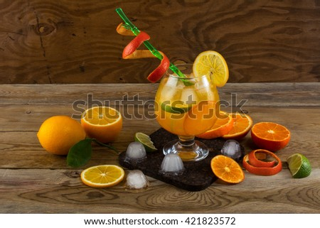 Tropical fruit cocktail on wooden table. Fruit cocktail. Fruit drink. Summer drink. Citrus lemonade. Fruit lemonade. - stock photo
