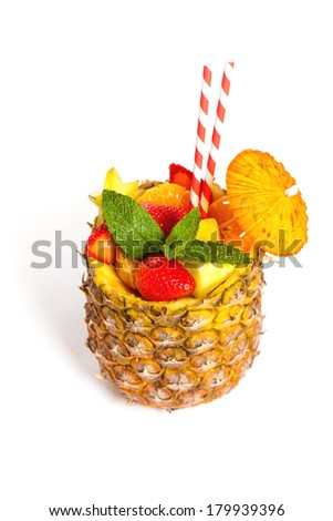 Tropical Fruit Cocktail prepared in pineapple - stock photo