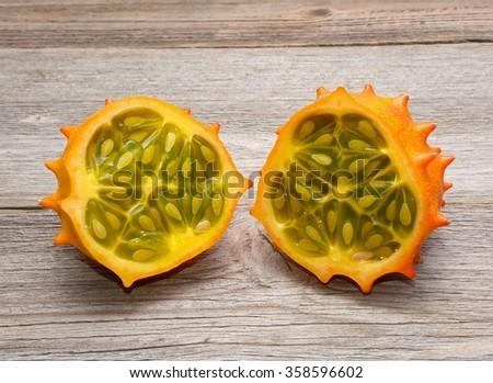 Tropical fruit Kiwano on wooden background - stock photo