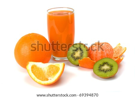tropical fruits and juice on white background - stock photo