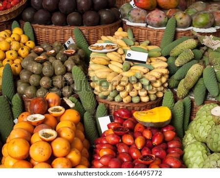 tropical fruits on market - stock photo