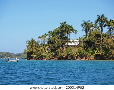 Tropical home with beautiful vegetation on an island in the Caribbean sea, Bocas del Toro, Panama - stock photo