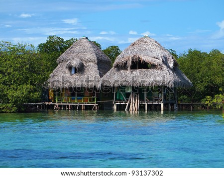 Tropical huts over the water with thatched roof, Caribbean sea, Panama