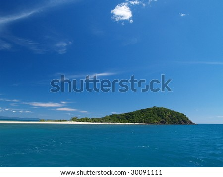 Tropical island at Great Barrier Reef - stock photo