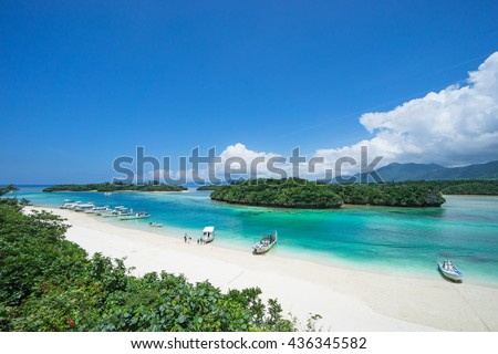 Tropical island beach with clear blue lagoon water, Okinawa, Japan - stock photo