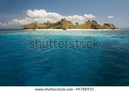 Tropical island in Komodo archipelago - stock photo