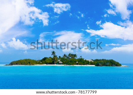 Tropical island in ocean - vacation background - stock photo