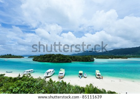 Tropical island lagoon with clear blue water and white sand coral beach, Ishigaki Island of the Yaeyama Islands, Okinawa, Japan - stock photo