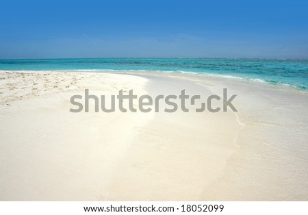 tropical island with beach and lagoon