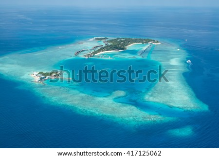 Tropical islands and atolls in Maldives from aerial view - stock photo