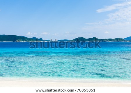 Tropical islands on the horizon over clear blue water of the coral lagoon, Aka Island, Okinawa, Tropical Japan - stock photo