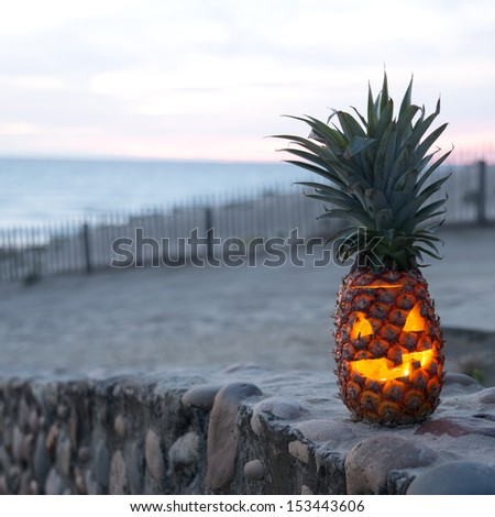 Tropical Jack O Lantern made out of pineapple - stock photo