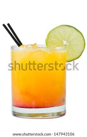 tropical juice cocktail isolated on a white background garnished with a lime wheel - stock photo