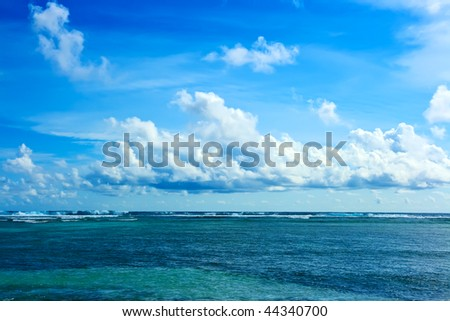 Tropical landscape. Infinity ocean and cloudy sky
