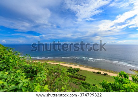 Tropical landscape with aerial ocean view. Secret surf spot. Bali island, Indonesia. Vacation background. - stock photo