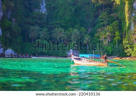 Tropical landscape with traditional long tail boat, Thailand Phi-Phi island. - stock photo
