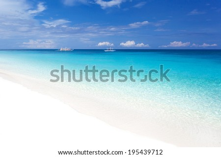 Tropical landscape with turquoise sea and white sandy beach, nobody - stock photo