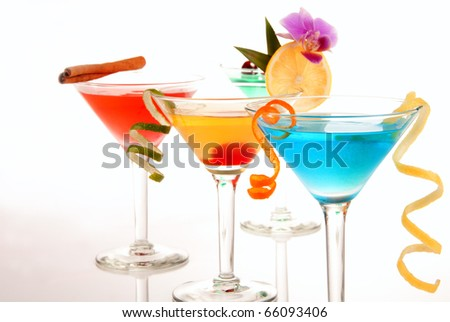 Tropical martini Cocktails with vodka, light rum, gin, tequila, blue curacao, lime juice, lemonade, lemon wheel  isolated on a white background - stock photo