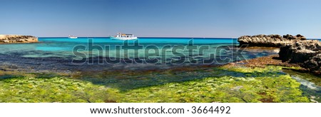 Tropical ocean and a boats - stock photo
