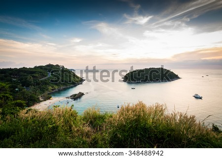 Tropical ocean landscape with little island under dramatic blue sky, Phuket, Thailand