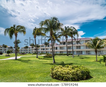 Tropical palm trees and sky at Cancun hotel - stock photo