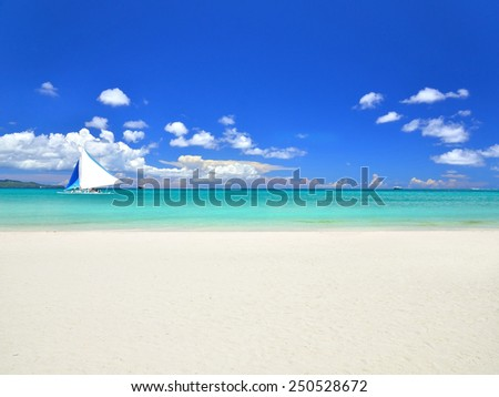 Tropical paradise beach with sailboat - stock photo