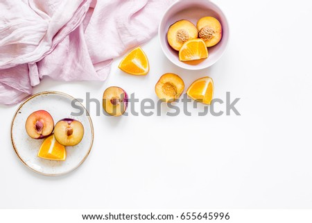 tropical peach and orange fruits for fresh juice with towel white background top view space for text