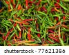 tropical peppers background, shallow depth of field - stock photo