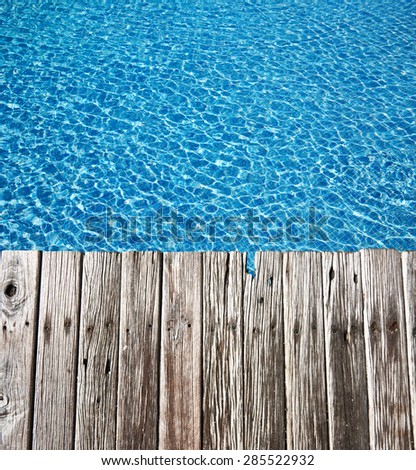 Tropical pool and old wooden pier - stock photo