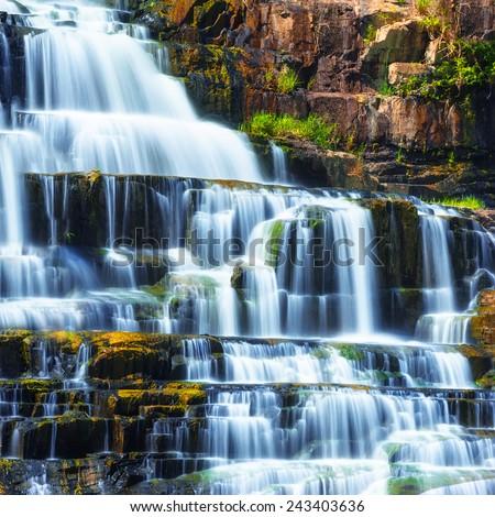 Tropical rainforest landscape with flowing Pongour waterfall. Da Lat, Vietnam - stock photo