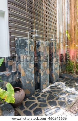 Tropical refreshing outdoor showers  - stock photo