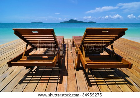 Tropical Resort Deckchairs - stock photo