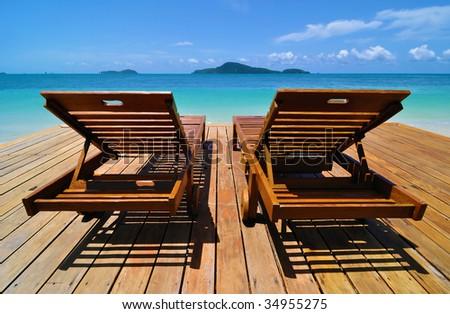 Tropical Resort Deckchairs - stock photo