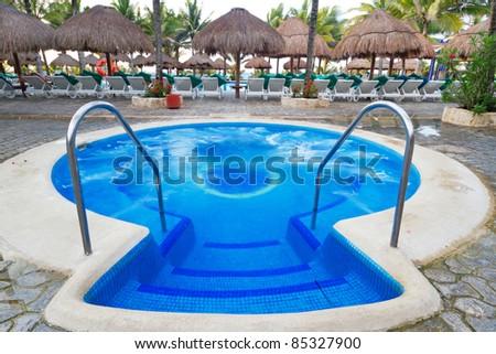 Tropical resort jacuzzi - stock photo