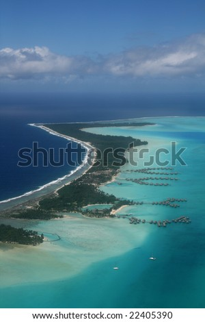 tropical resort on a pacific island coral reef - stock photo