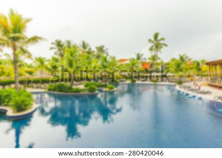 Tropical resort pool - stock photo