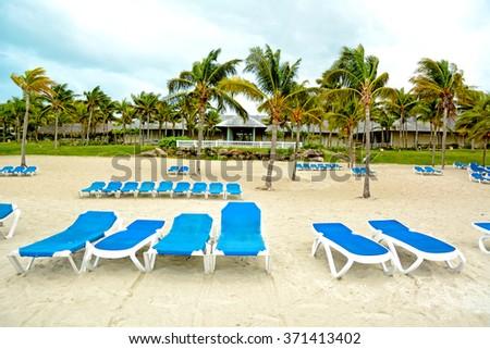 Tropical resort, sandy beach - stock photo