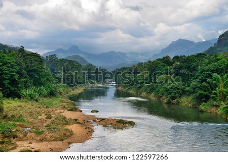 Tropical river. The river flowing in the country of Sri Lanka - stock photo