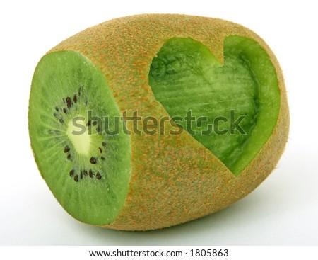 Tropical romantic love heart kiwi fruit, isolated, closeup - stock photo