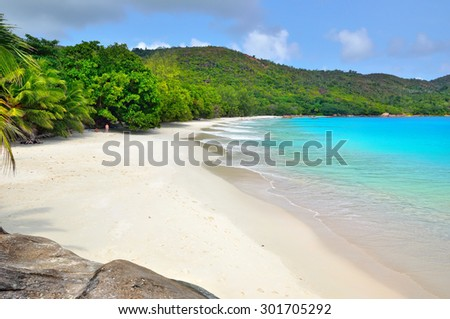 Tropical sand beach with granite rocks on Seychelles islands, Praslin, Anse Lazio - stock photo