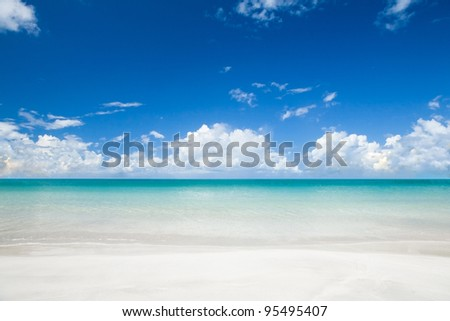 Tropical sandy beach at summer sunny day. - stock photo