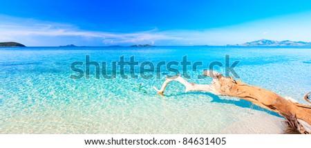 Tropical sandy beach at summer sunny day. Panorama - stock photo