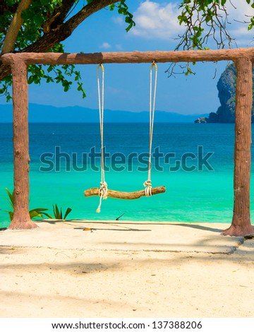 Tropical Scene Seaside Swing - stock photo