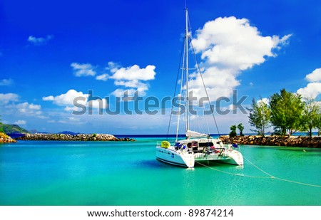 tropical scenery with yacht - stock photo