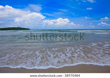 Tropical sea and far island - stock photo
